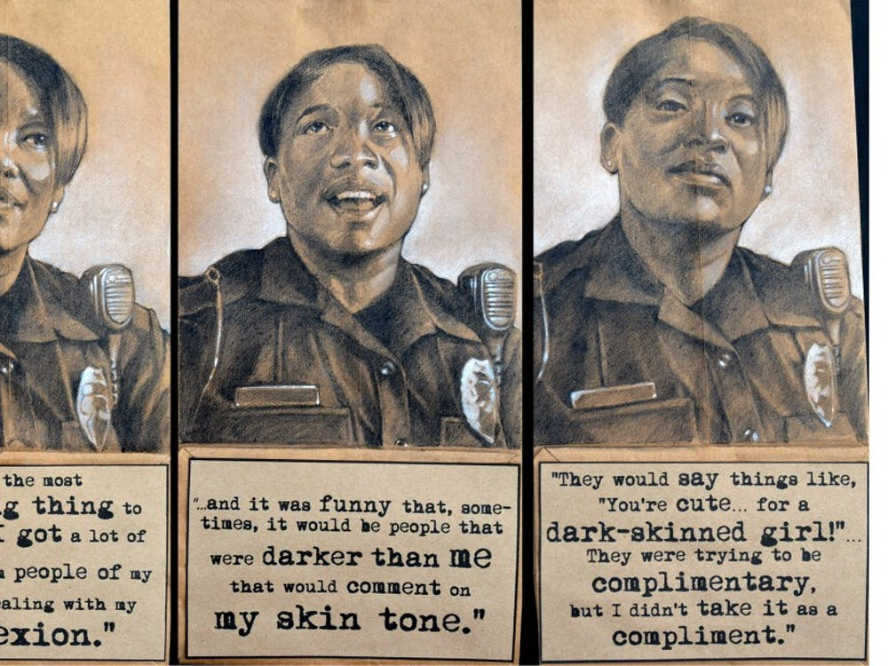 Officer Watkins discusses struggles she had growing up related to comments and treatment by other African Americans because of her dark skin tone. Triptych, charcoal, pastel, and collage on brown paper bags, 2014, by Steven M. Cozart, winner of the 2016 Lange-Taylor Prize.