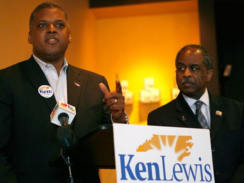 Kenneth Lewis, Trinity '83, accepts an endorsement from Durham Mayor Bill Bell for the Democratic Party's U.S. Senate nomination. Bell announced his support for Lewis, a Durham attorney, at Beyu Caffe Monday.