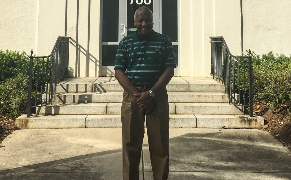 Phail Wynn in front of the Durham and Regional Affairs Office in June.