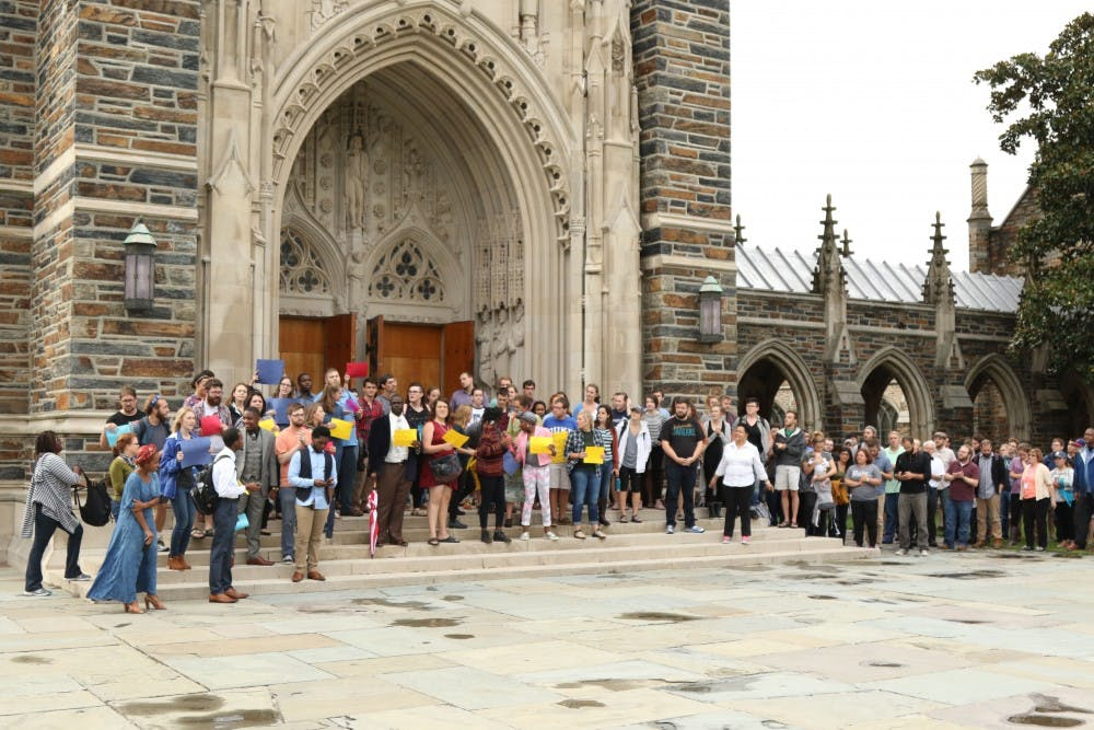 <p>About 100 Divinity School students protested in front of the Chapel Wednesday following the police shooting of Keith Lamont Scott.</p>