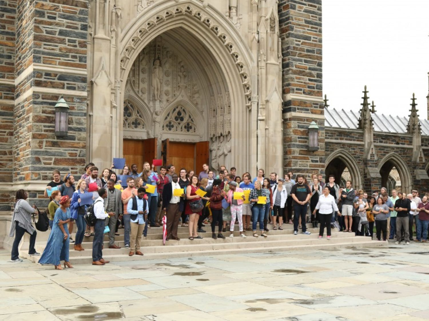 About 100 Divinity School students protested in front of the Chapel Wednesday following the police shooting of Keith Lamont Scott.