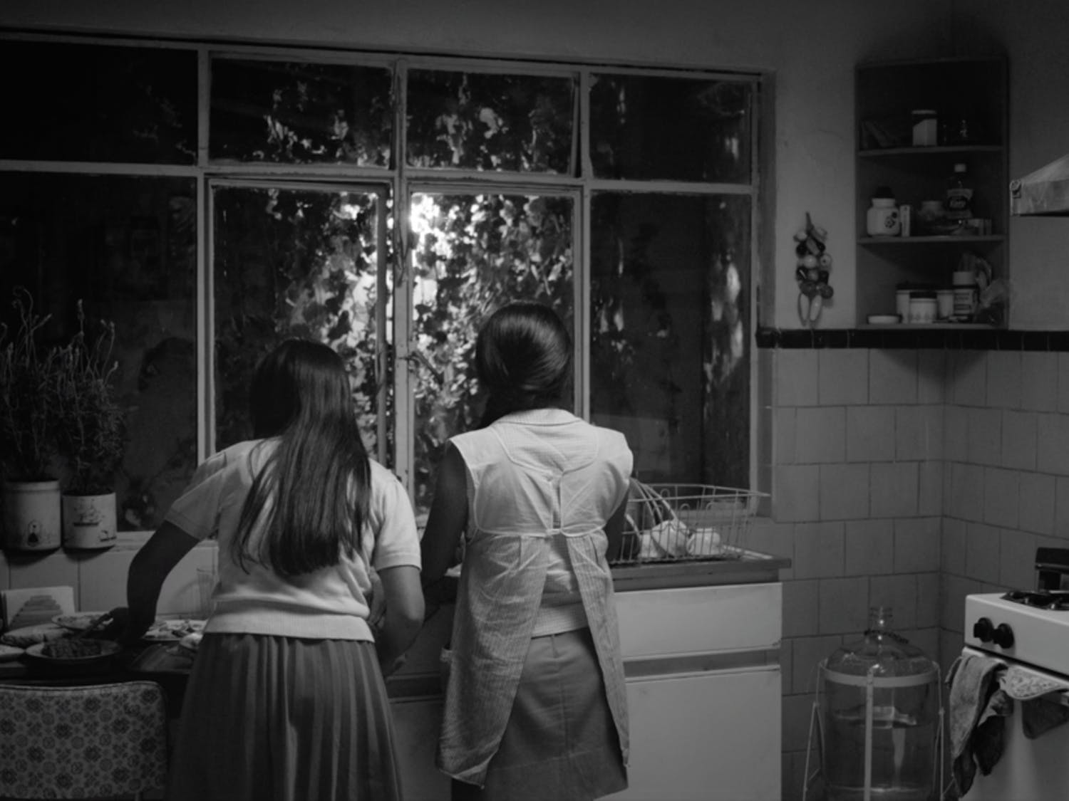 "Alfonso Cuarón's ""ROMA"" follows the story of Cleo, a housekeeper for a middle-class family in Mexico City."