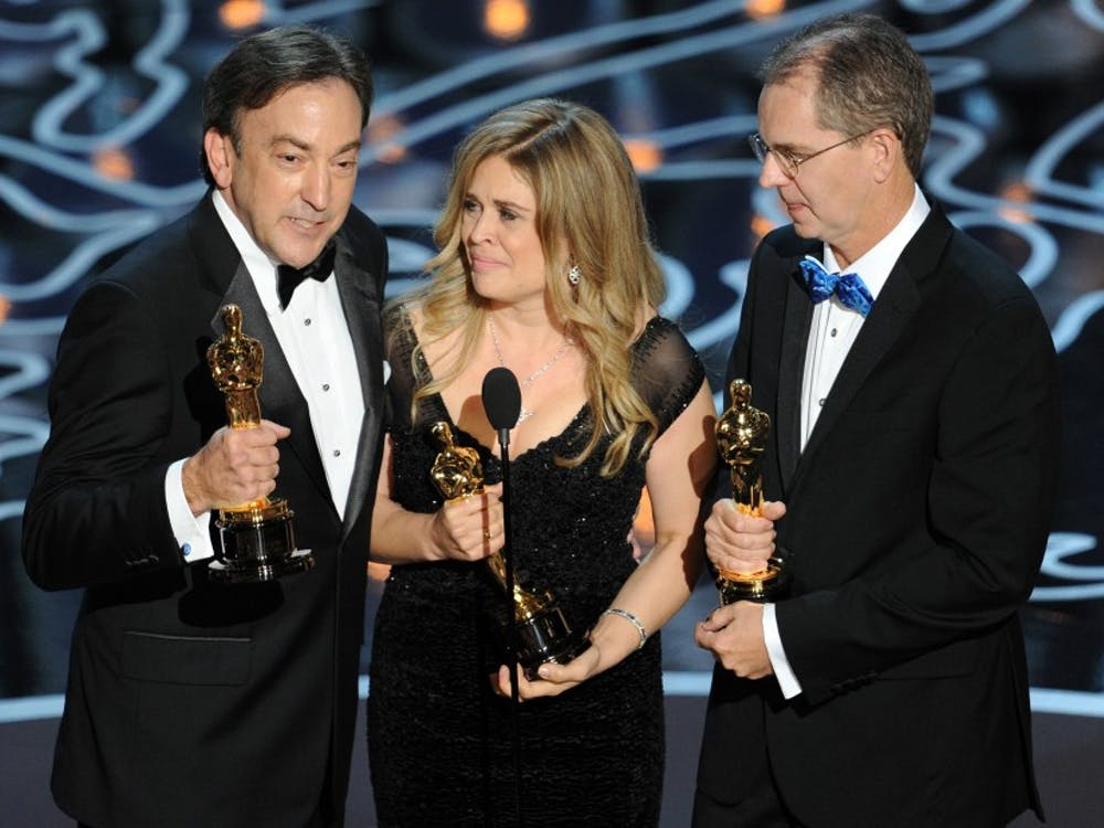 HOLLYWOOD, CA - MARCH 02:  (L-R) Producer Peter Del Vecho, directors Jennifer Lee and Chris Buck accept the Best Animated Feature Film award for 'Frozen' onstage during the Oscars at the Dolby Theatre on March 2, 2014 in Hollywood, California.  (Photo by Kevin Winter/Getty Images)