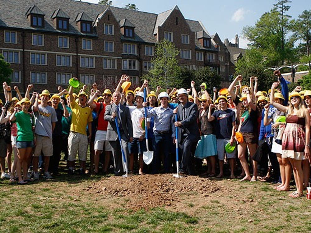 President Richard Brodhead (left) and Steve Nowicki (front row, right), dean and vice provost for undergraduate education, break ground on the K4 residence hall Friday. The building, which would complete the Keohane Quadrangle, marks the beginning of a new housing model for Duke.