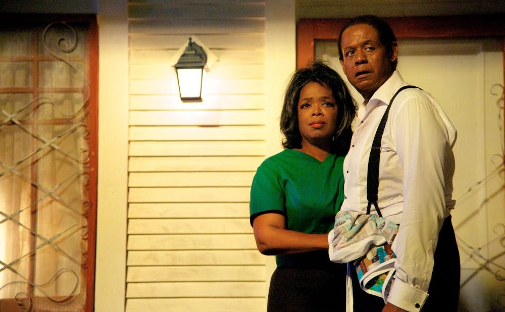"""This film image released by The Weinstein Company shows Oprah Winfrey as Gloria Gaines, left, and Forest Whitaker as Cecil Gaines in a scene from """"Lee Daniels' The Butler."""" (AP Photo/The Weinstein Company, Anne Marie Fox) ORG XMIT: NYET138"""