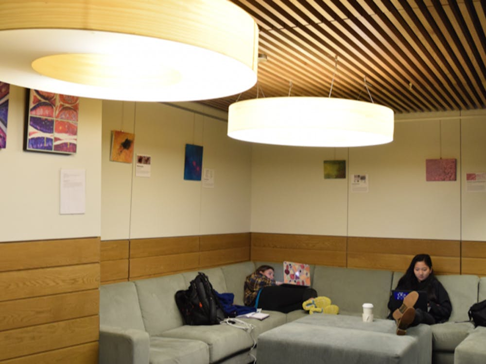 "Students study in the lounge adjacent to Au Bon Pain in the Brodhead Center, which houses the ""Art of Science"" exhibit space."