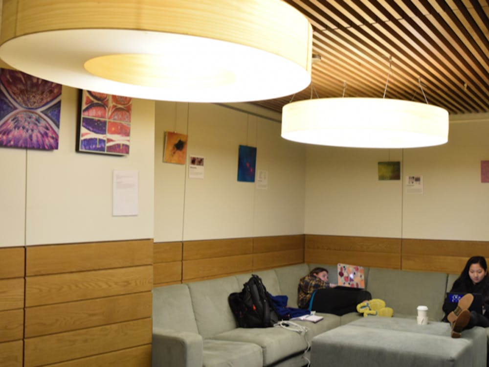 """Students study in the lounge adjacent to Au Bon Pain in the Brodhead Center, which houses the """"Art of Science"""" exhibit space."""