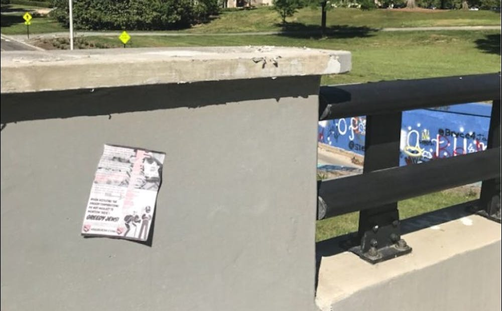 One of the posters was found taped to the wall, while the other was found upside down on the sidewalk.