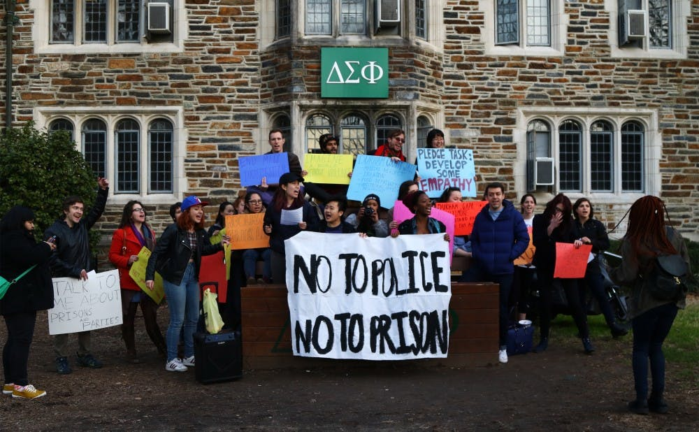 <p>Protestors tried to explain to a large crowd of onlookers why they advocate for the abolishment of the U.S. prison system and Greek life on campus.&nbsp;&nbsp;&nbsp;</p>