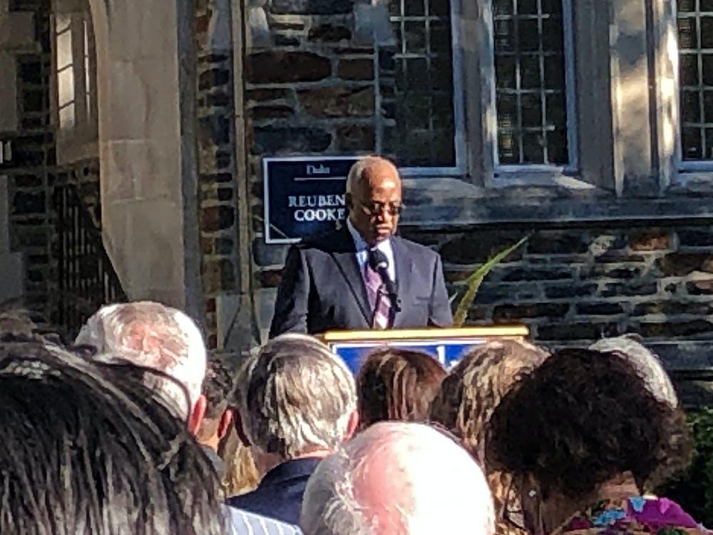 Ed Cooke speaking at the Reuben-Cooke Building dedication ceremony.