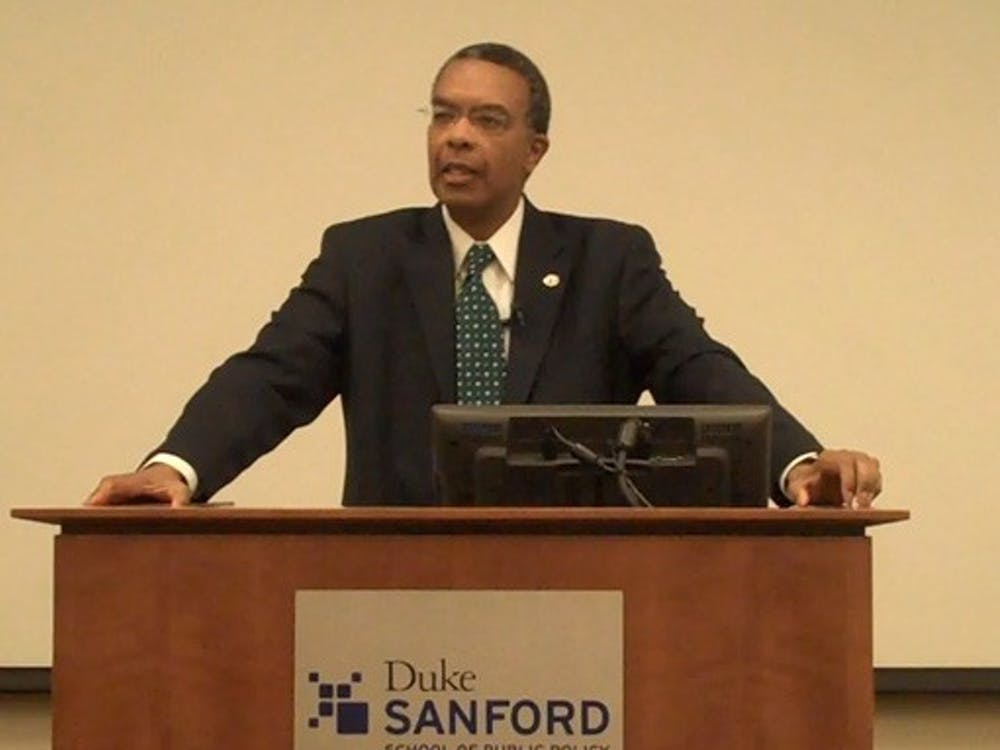 "Aaron Williams, director of Peace Corps, speaks in the Sanford School of Public Policy Thursday afternoon. Williams urged students to join the volunteer organization, touting it as ""the humanitarian face of America."""