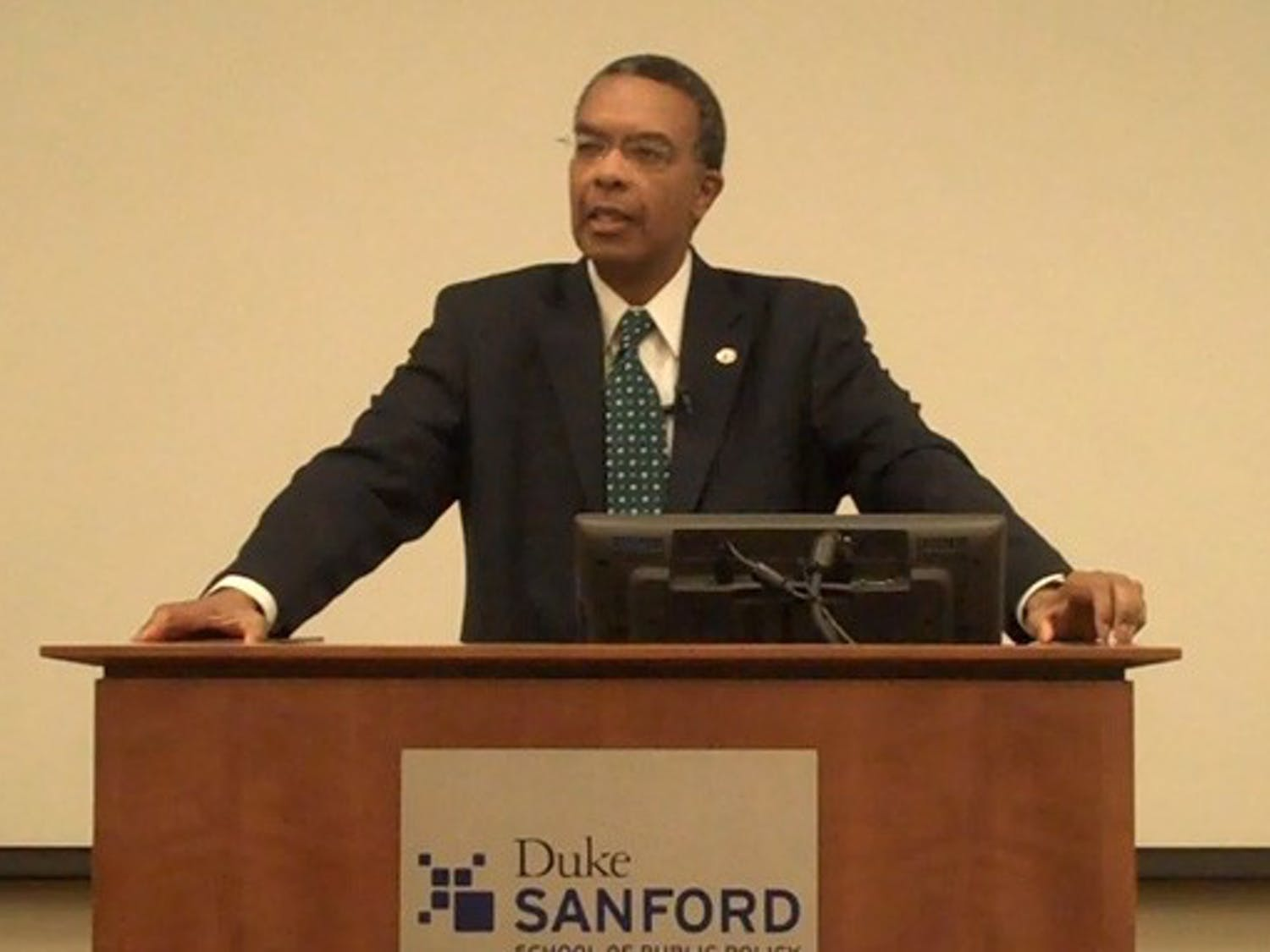 """Aaron Williams, director of Peace Corps, speaks in the Sanford School of Public Policy Thursday afternoon. Williams urged students to join the volunteer organization, touting it as """"the humanitarian face of America."""""""