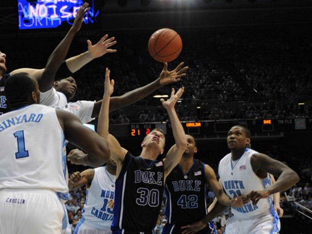 Duke's Brian Zoubek and North Carolina's Ed Davis, among many other players, battle for a loose ball during the Blue Devils' 10-point win in Chapel Hill Wednesday.