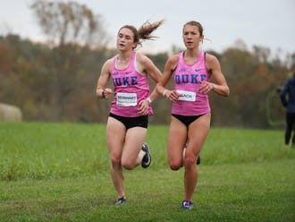 Seniors Michaela Reinhart (left) and Amanda Beach (right) have paced the Blue Devil women in each of the two races they've competed in this season.