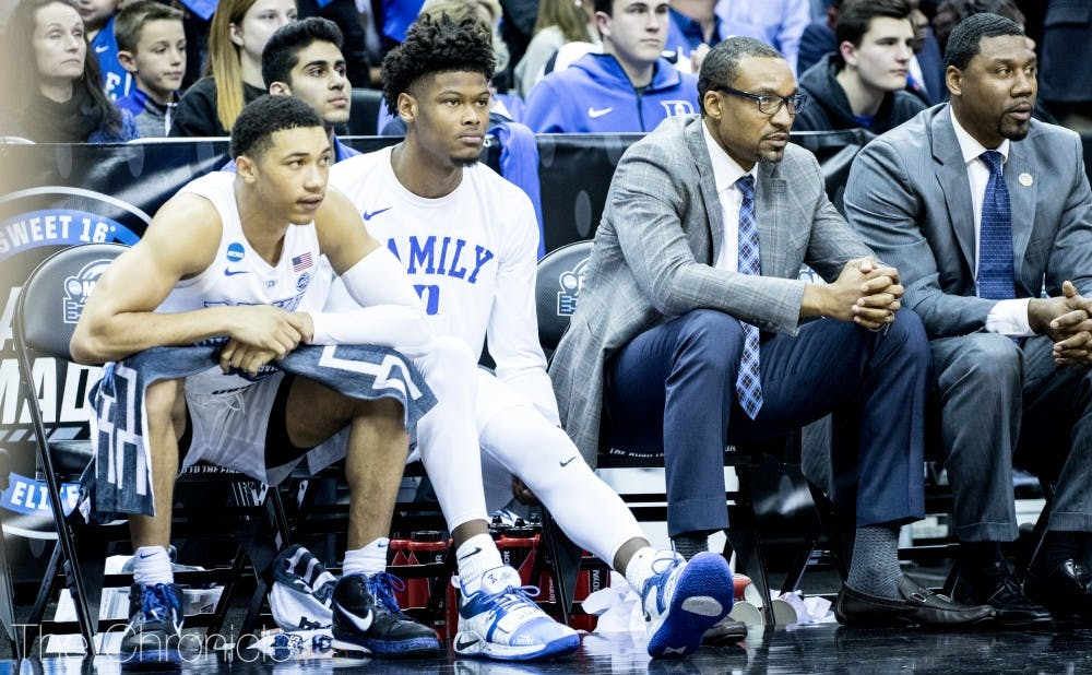 <p>Cam Reddish sat out Friday's Sweet 16 game with knee soreness after he said he tweaked it on Thursday.</p>