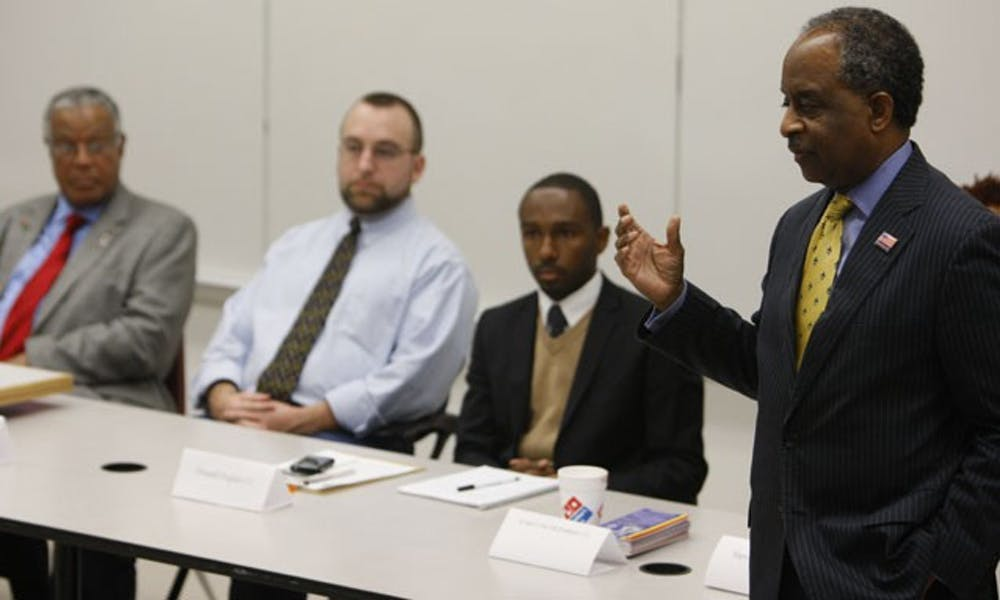 Durham Mayor Bill Bell speaks at an on-campus forum Monday night in front of an audience of about 30 people. The event brought city council candidates to Duke to debate issues surrounding the city.