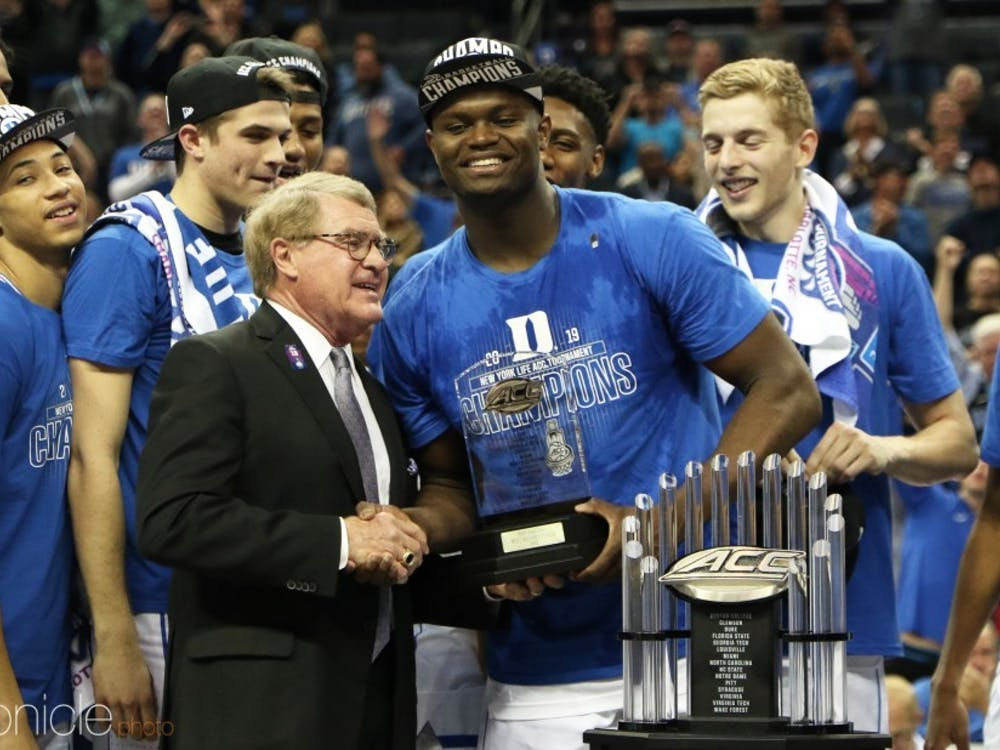 ACC Commissioner John Swofford awarding the MVP of the 2019 ACC tournament to Zion Williamson.