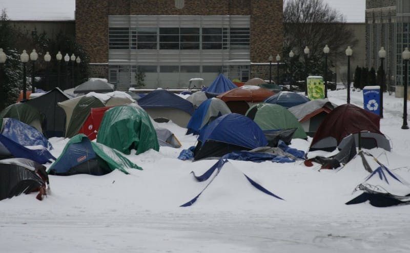 A blanket of snow covers K-Ville tents in 2010. Numerous students join tenting groups each year to secure tickets to the Duke-UNC home basketball game.