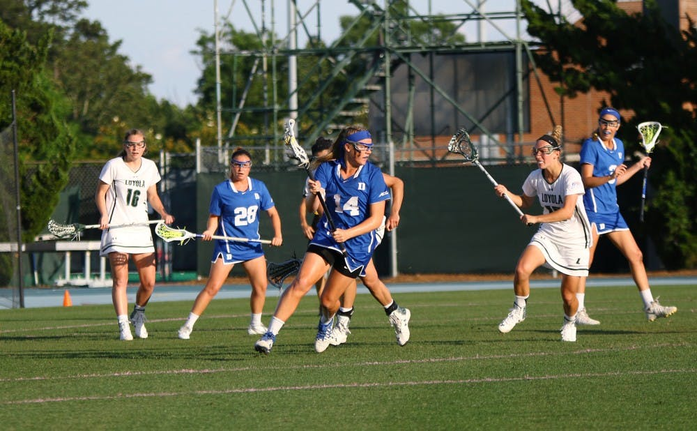 <p>Freshman Olivia Jenner dominated faceoffs Friday to help Duke control the ball on offense&nbsp;for much of the game.</p>