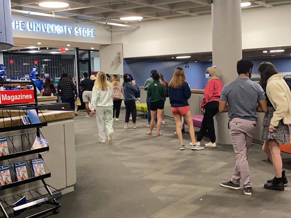 """<p>The line at the Lobby Shop was out the door as students flocked to buy food in advance of Duke's announcement of a """"stay-in-place"""" directive, although the final directive said students could leave their rooms or come to campus to buy food.&nbsp;</p>"""