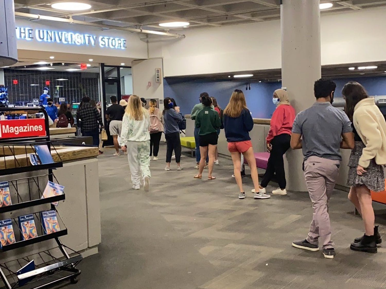 """The line at the Lobby Shop was out the door as students flocked to buy food in advance of Duke's announcement of a """"stay-in-place"""" directive, although the final directive said students could leave their rooms or come to campus to buy food."""