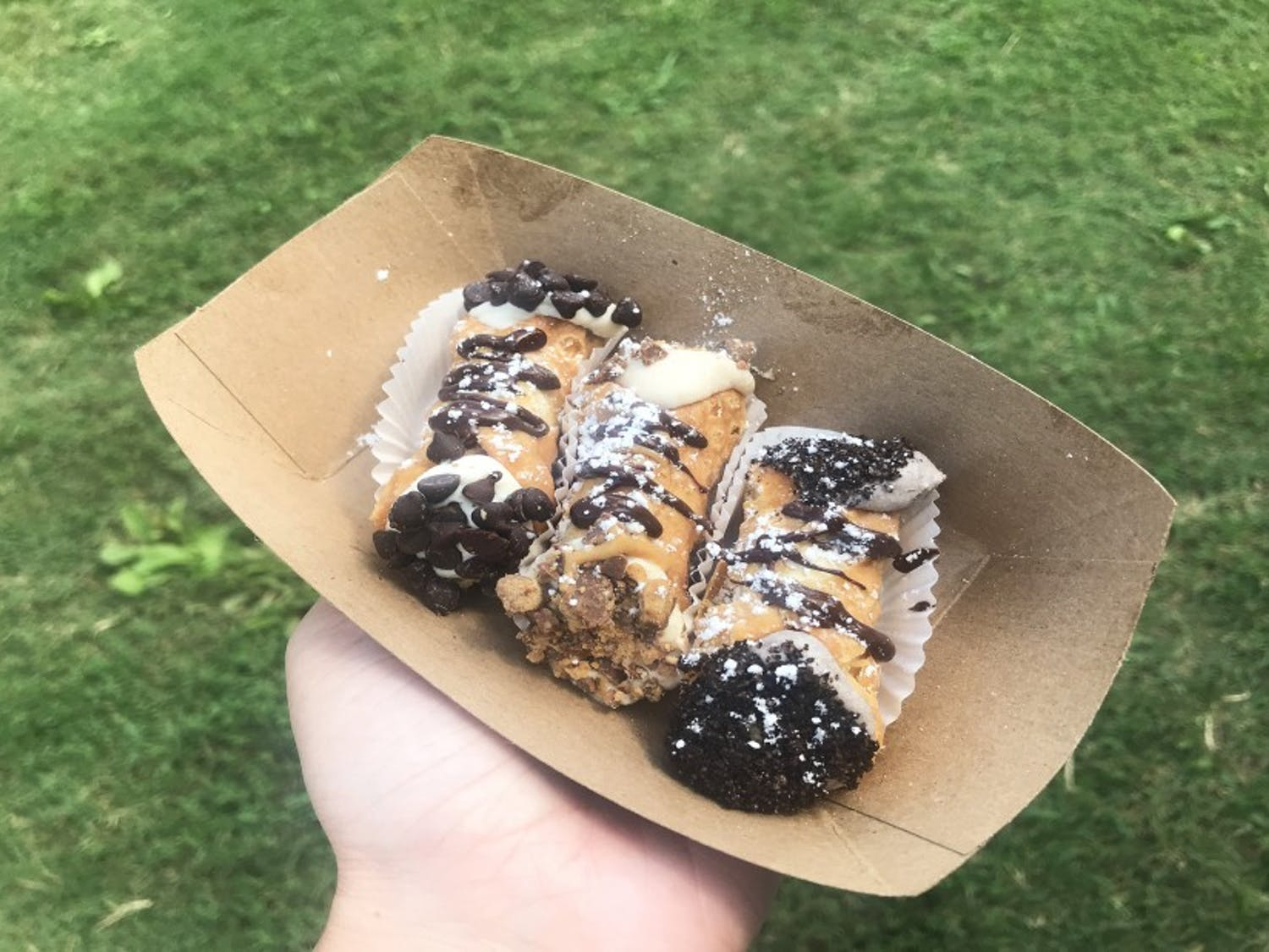 Holy Moly Cannoli offers a rotating menu of toppings and a selection of choices for the base.