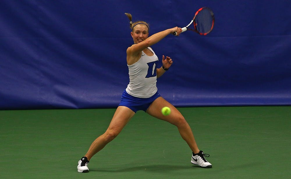 <p>With senior Beatrice Capra unable to play on Senior Day due to illness, freshman Ellyse Hamlin stepped up and clinched a Duke win for the second straight match Tuesday.</p>