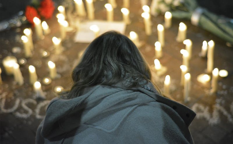 Members of the Triangle community gathered for a vigil in Chapel Hill earlier this month following the murder of three local college students.