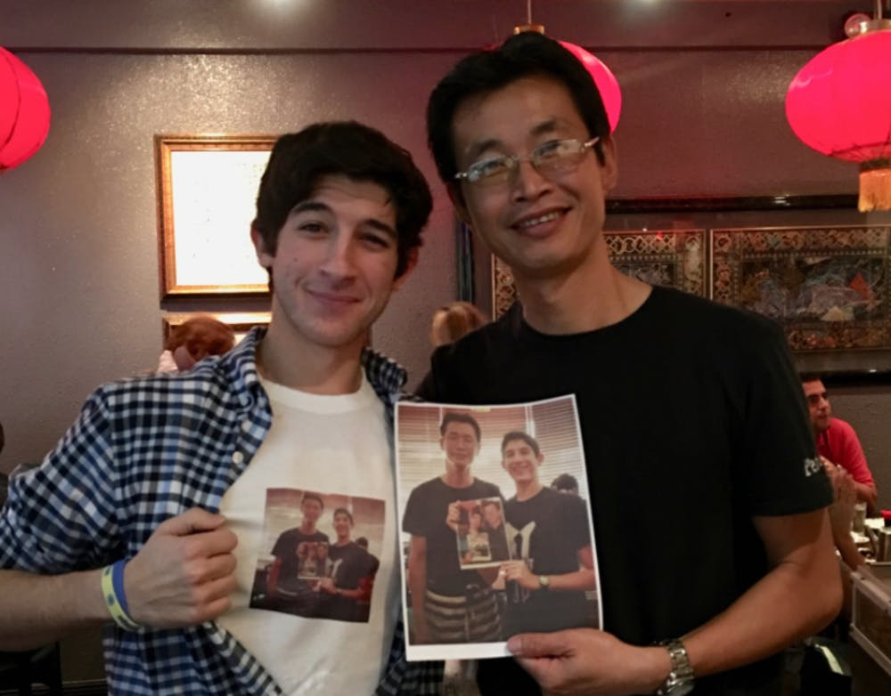 <p>Besner (left) poses with waiter Peter Chung (right).</p>