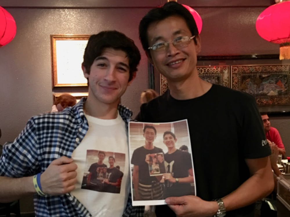 Besner (left) poses with waiter Peter Chung (right).