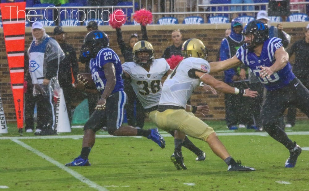 <p>Running back Shaun Wilson broke loose for multiple runs for first downs to help run out the clock in the fourth quarter against Army.</p>
