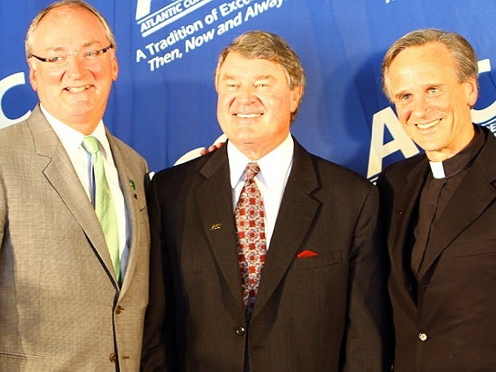 John Swofford (center) announced Thursday morning that ACC tournament games will be played despite coronavirus concerns.