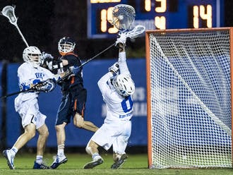 Goalie Mike Adler's save at the buzzer clinched the win for the Blue Devils.