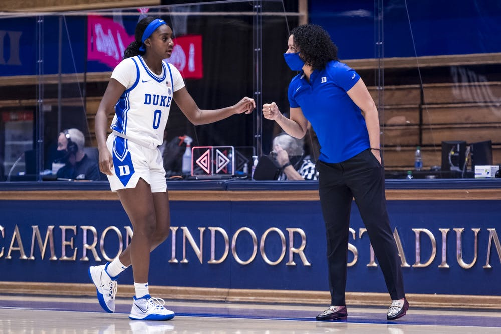 <p>Lawson, pictured here with Jaida Patrick, made history Wednesday afternoon as Duke basketball's first Black head coach.</p>