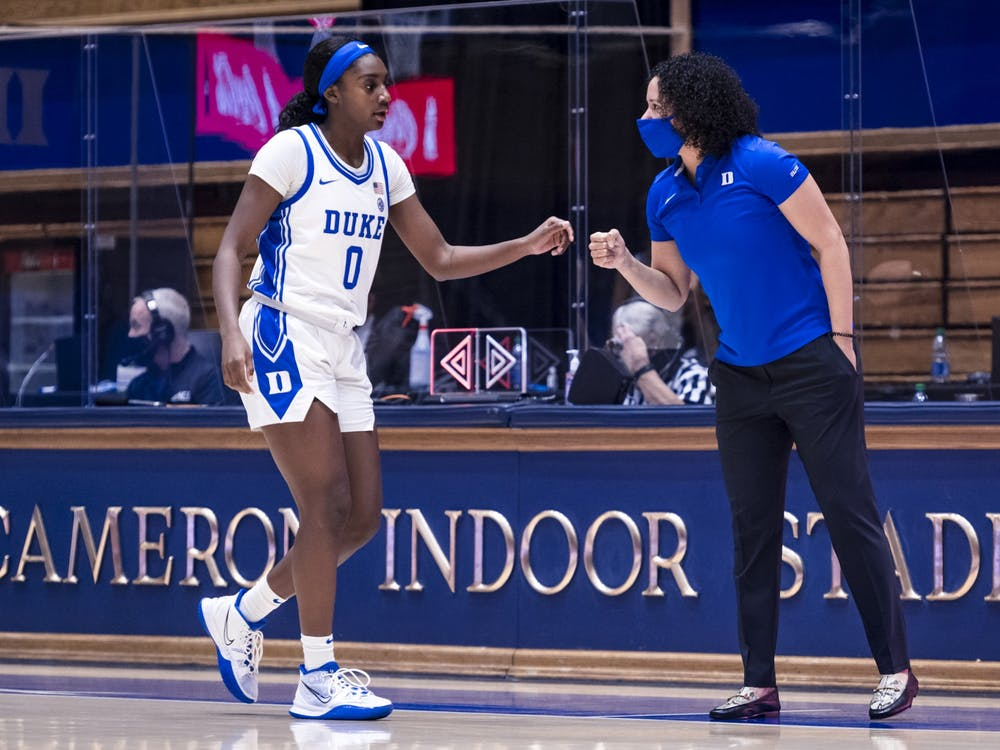 Lawson, pictured here with Jaida Patrick, made history Wednesday afternoon as Duke basketball's first Black head coach.