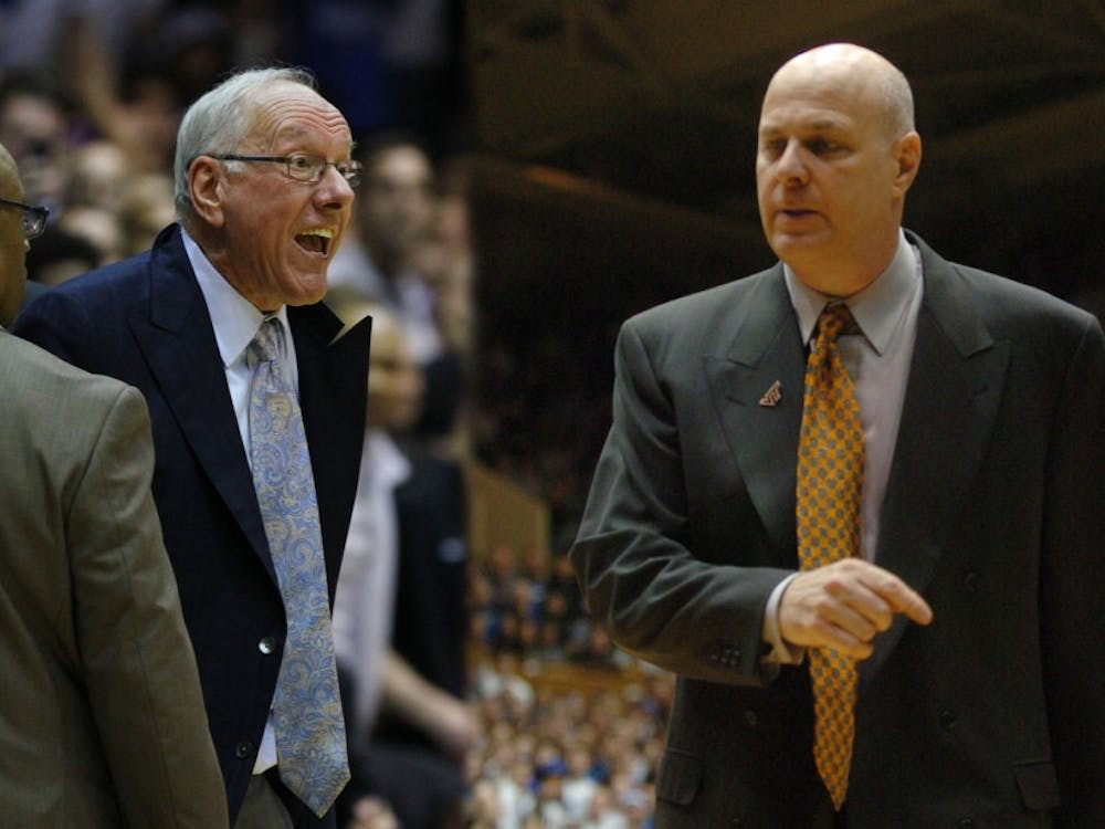 Current ESPN analyst and former Virginia Tech head coach Seth Greenberg (right) explains what may have been running through the head of Syracuse head coach Jim Boeheim (left) when he got ejected from his team's loss to Duke Saturday.