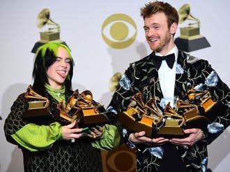 Billie Eilish (pictured with brother and producer Finneas O'Connell) swept the four major categories at the Jan. 26 Grammy Awards.