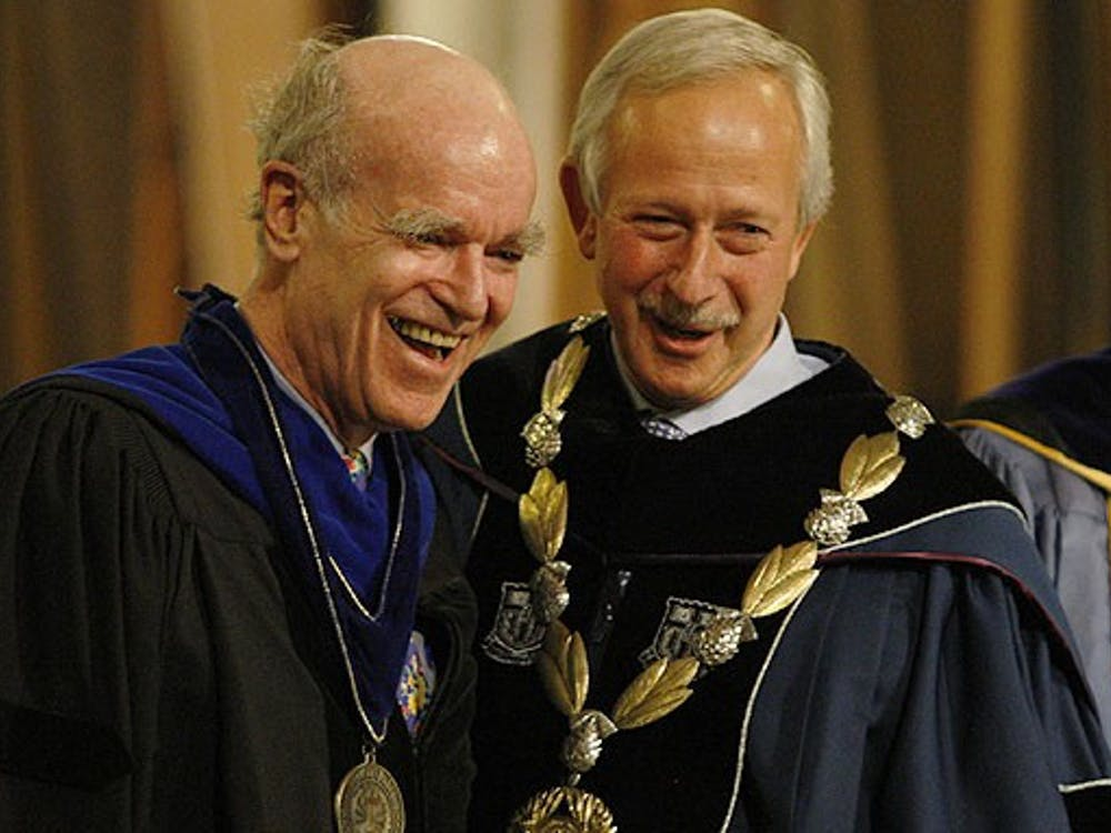 Professor Joel Fleishman (left) receives the University Medal for Distinguished Service from President Richard Brodhead (right) during the Founder's Day Convocation in the Chapel Thursday.