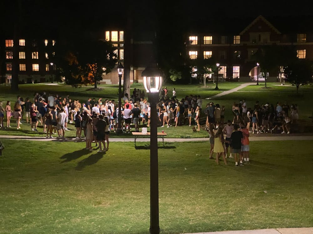 <p>A large number of students gathered outside Gilbert-Addoms dorm on East Campus the night of Aug. 12.</p>