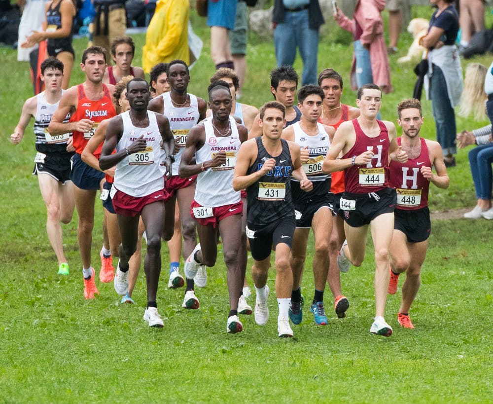 Graduate student CJ Ambrosio (center) led the Blue Devil men with an 11th-place showing in the eight-kilometer race.