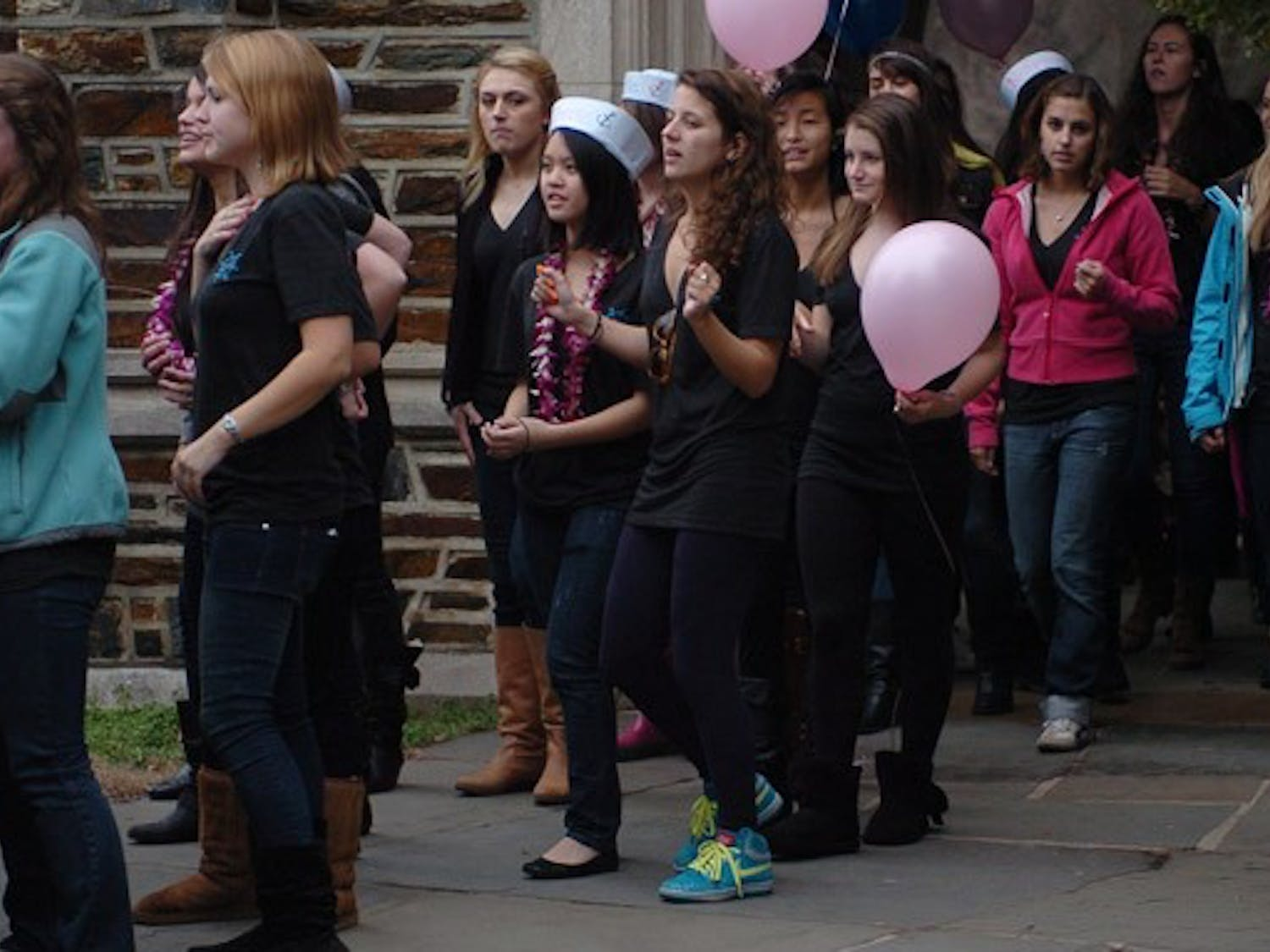 New members of Delta Gamma celebrate their offers during the annual Bid Day Sunday afternoon.