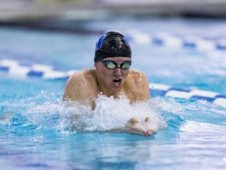 Junior Cole Reznick swam his way into the record books this past weekend.
