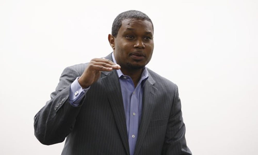 Durham mayoral candidate Steven Williams speaks at a campaign event Monday night. Williams criticized Mayor Bill Bell on his approach to the lacrosse case.