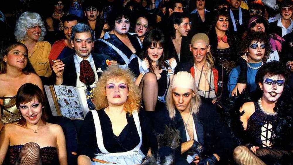 "Fans of the seminal cult classic ""Rocky Horror Picture Show,"" in full costume, at a midnight screening of the film."