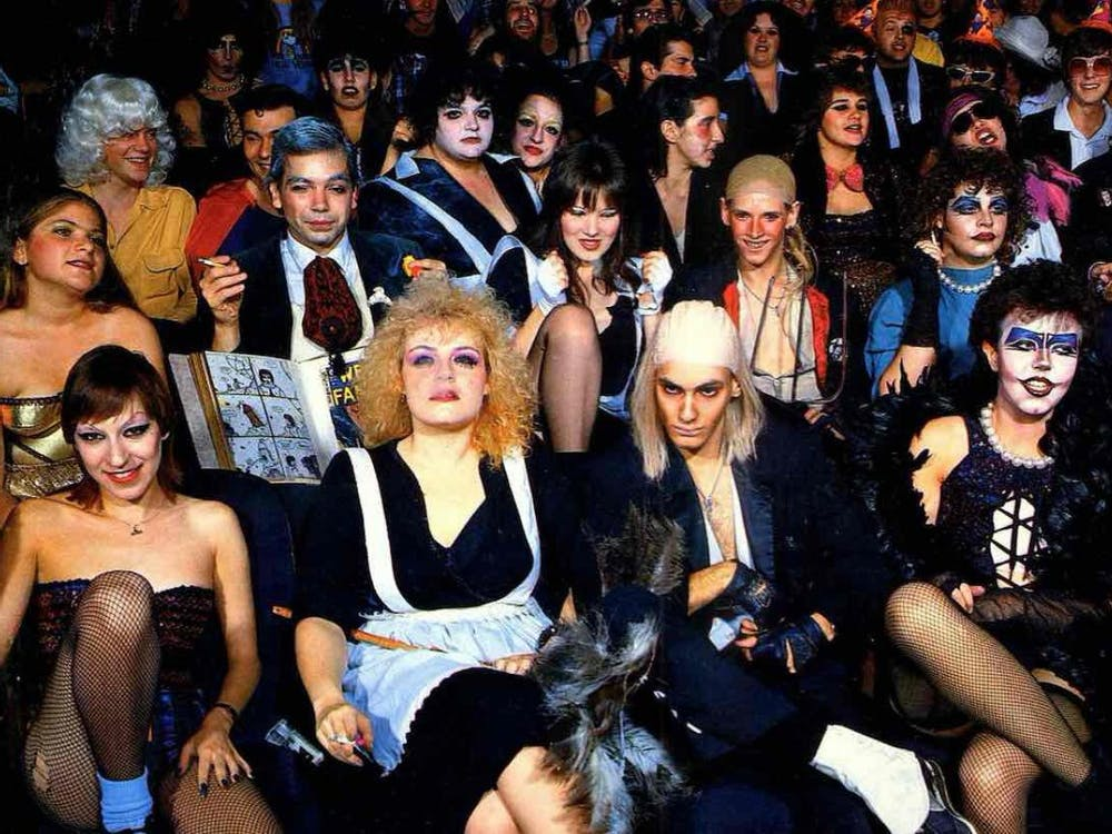 """Fans of the seminal cult classic """"Rocky Horror Picture Show,"""" in full costume, at a midnight screening of the film."""