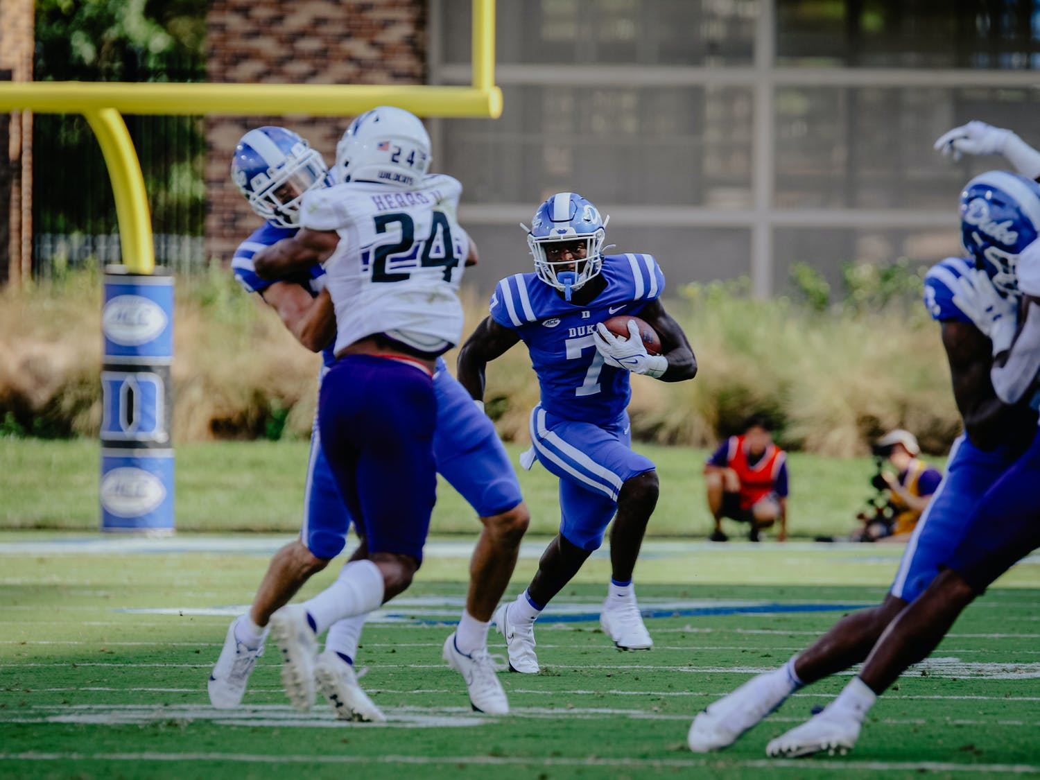 In a Saturday evening game, the Wildcats valiantly clawed their into a sizeable large Duke Blue Devil lead during the second half, but the Blue Devils hang on, winning the game over the Wildcats 30-23. Photos by Staff Photographer Aaron Zhao and Associate Editor Zoé Murphy.