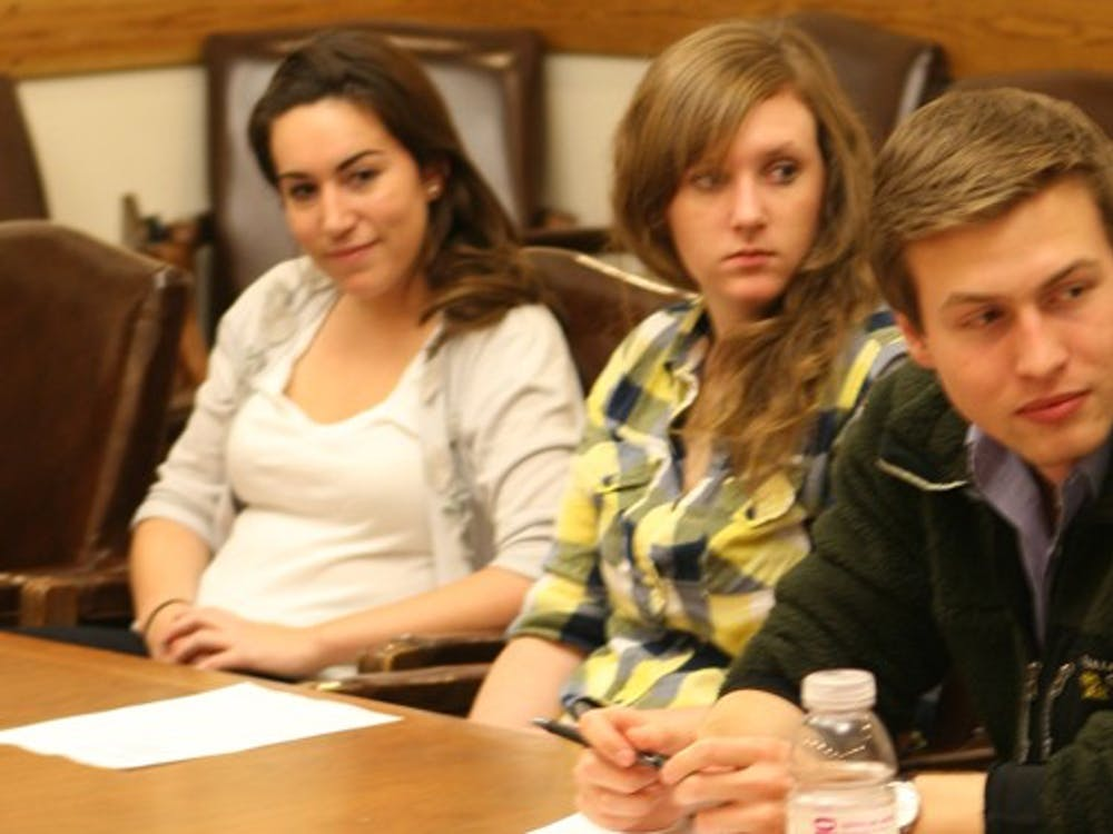 Merideth Bajana, Holly Little, and DUU President Zach Perret hear proposals for the reorganization of student group funding at Tuesday's DUU meeting.