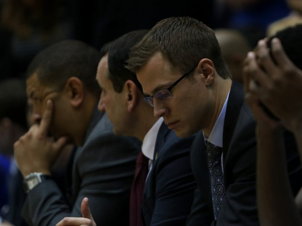 The Duke bench watched as Miami used a 9-0 run and a 10-0 run early in the second half to pull away from the Blue Devils and end the longest home-court winning streak in Division I.