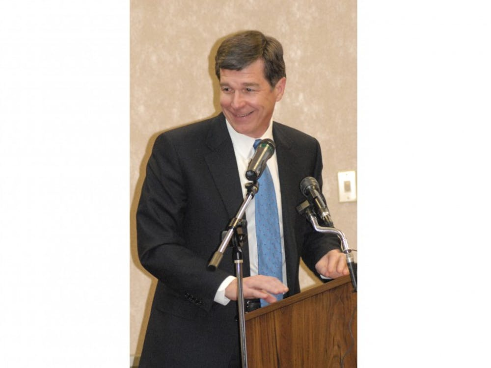 Roy Cooper, North Carolina Attorney General, gives a keynote address to Airmen during the opening ceremony of Military Saves Week at the Airman and Family Readiness Center Feb. 23.