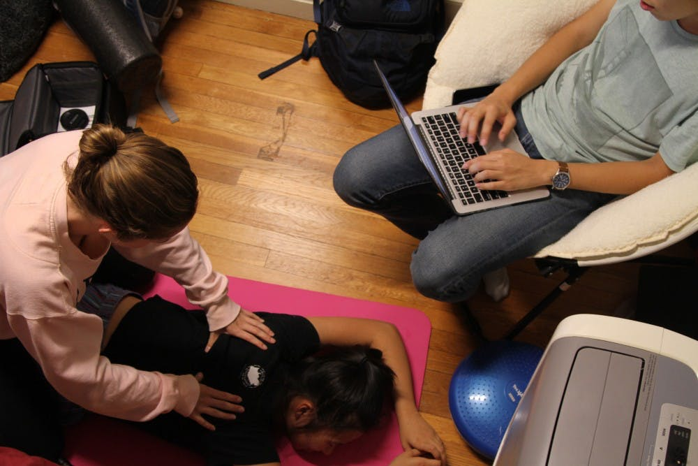 <p>First-years Lyndsay Hastings and Yuexuan Chen took turns giving back massages to help de-stress.</p>